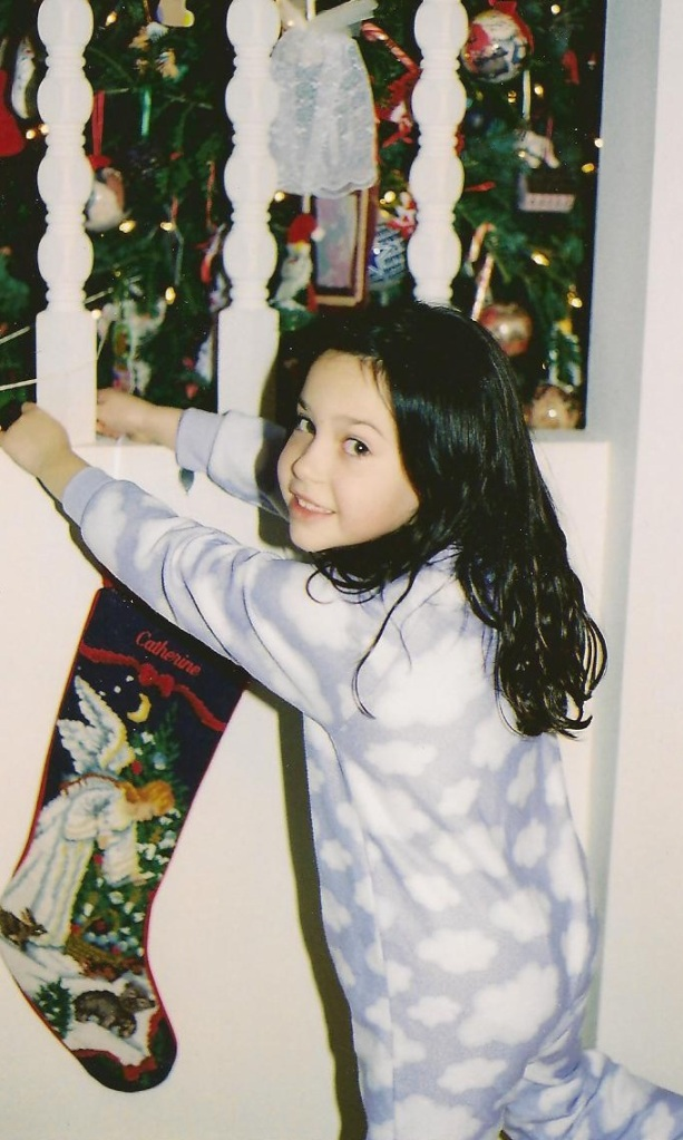 Catherine -- probably age 7 (I REALLY need to make those photo albums) -- getting ready for Santa's arrival.