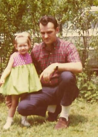 Me and Dad in 1968. I am 2 here. And no, I don't know why Dad looks so serious, but I love that even then he was still wearing his favorite 'do: The DA. (And I am rocking a pretty cool hair bow!)