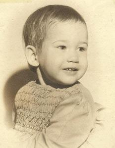 Here I am, 20 months old. Thankfully, the photographer had the wherewithal to pose me so my Dumbo ears were not noticeable, because heaven knows my hair was taking its sweet time to grow.