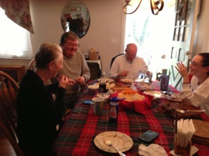 This is the only halfway decent Christmas picture I could get out of these jokers. From left: Mom, Basil, Dad and Catherine, taking the edge off with some snacks before dinner on Tuesday.