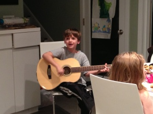 James performs for us. At right is Lily, then still a master of her own piece of carrot cake.