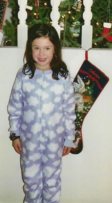 Catherine and her freshly displayed Christmas stocking in 2002. What a difference a decade makes!