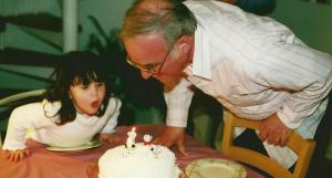 Blowing out the candles with Grandpa in 2000.