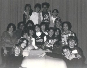 "Cast and crew of ""Grease,"" 1980, Port Chester (NY) Junior High. First of all, I can't believe how young we all are. I'm the only person wearing glasses. You likely see two of the faces in the photo on television today. One of the fellas is a choreographer, another plays in a band. The rest of us all grew up and assumed a variety of jobs. Still, if you put us together in one room, we could do a hell of a hand jive."