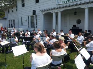Rye Town Community Band performs last June. I'm there, in the center, between the girl with very long hair and the fellow in the baseball cap.