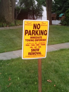 Here in Connecticut, we're enduring hot, humid weather, so you can imagine my surprise to find these signs dotted around the neighborhood. Turns out there is no weather anomaly; the streets are being paved. Still this made me laugh -- until I got several yards down the road after snapping this photo and the skies opened up with torrential rain.