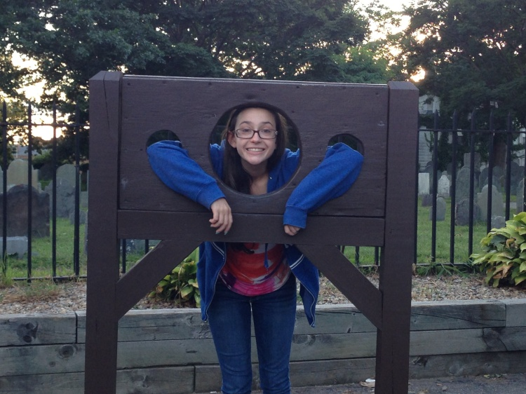 Catherine cools her heels in the stocks during our visit to Salem last week.