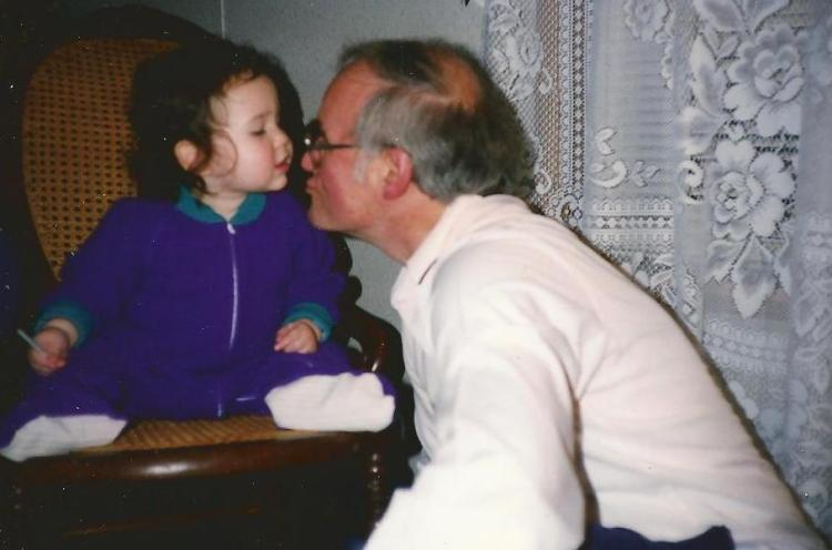 Many years and several sets of curtains ago, Catherine gives Grandpa a kiss.
