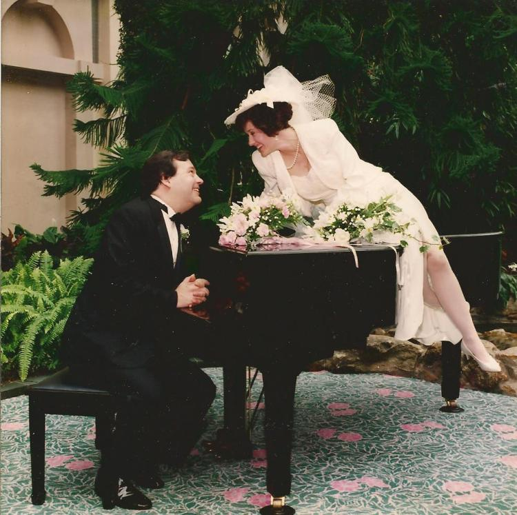 Neither of us plays piano, but it was a prop worth exploiting in the atrium of the Hyatt Regency, Old Greenwich. That goodness we rented it for photos; it poured rain all day. Showers of happiness, everyone assured us.