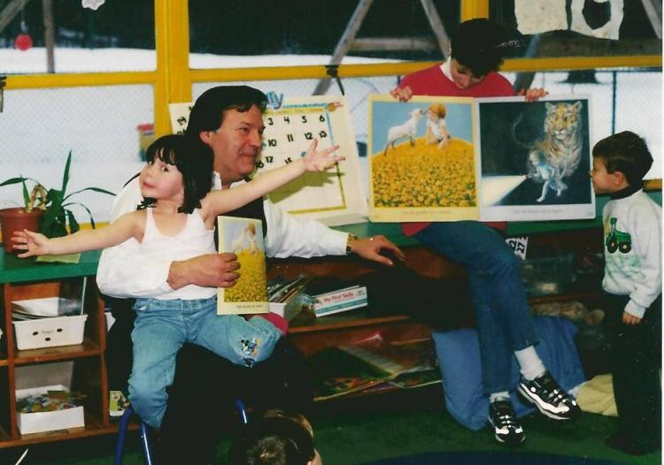 Basil and Catherine read to the kids at Mead School 13 years ago. This is back when Catherine was still very shy.
