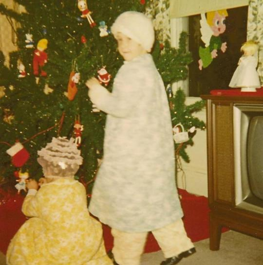 Trimming the tree, 1971. I'm at right, and I'm not wearing a swim cap. There are curlers in my hair.