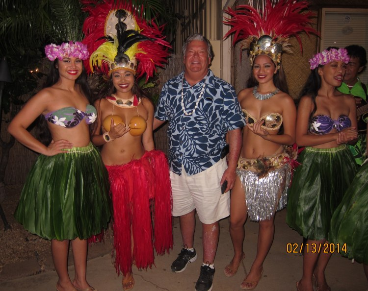 Basil and the hula girls following his turn on stage during the dinner cruise night of the Greenwich High choir's recent trip to Honolulu.