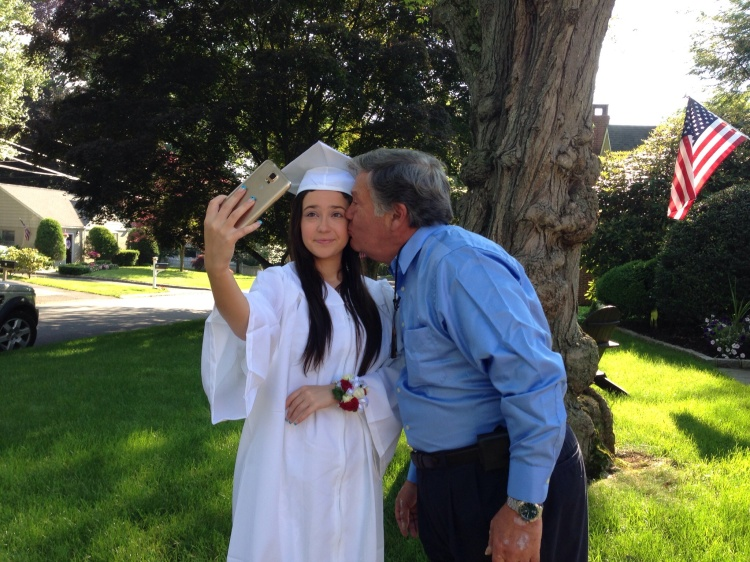 """I'm going to graduation, but first let me take a selfie."""