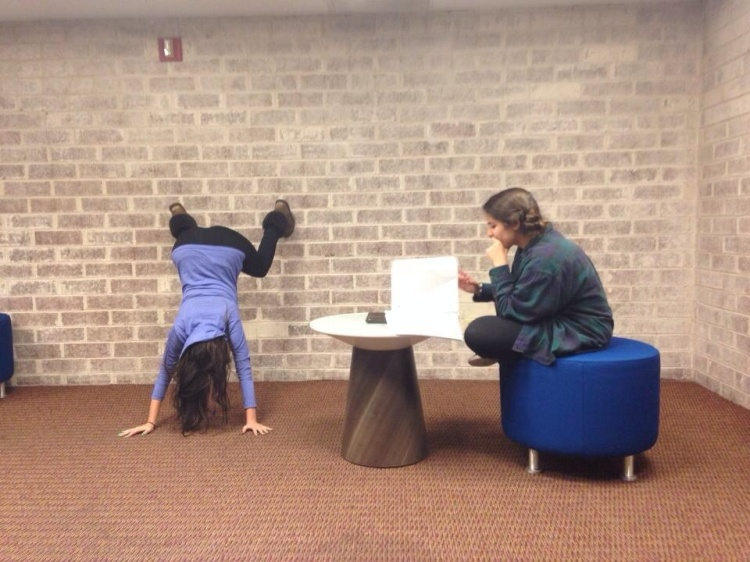 That's Catherine, attempting a handstand in the lounge of her dorm.
